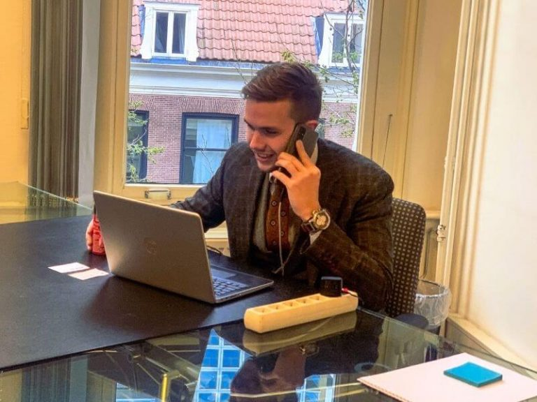Account Manager Okko Uitenbroek on Phone Call at the Office with Laptop