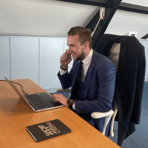 Account/Sales Manager Okko Uitenbroek on Phone Call at the Office with Laptop